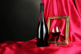 Composition of frame and wine on bright background — Stock Photo