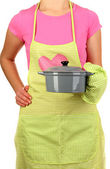 Closeup of homemaker in apron holding pan isolated on white — Stock Photo