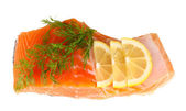 Fresh salmon fillet with herbals and lemon slices, isolated on white — Stock Photo