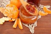 Tasty homemade mandarine jam, on wooden table — Stock Photo