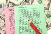 Billete de lotería con lápiz y dinero, aislado en blanco — Foto de Stock