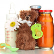 Baby food, bottle of milk and juice with teddy bear isolated on white — Stock Photo #19470279