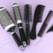 Black combs on color background — Stock Photo #19471223
