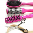 Comb brushes, hair and cutting shears, isolated on white - Foto Stock