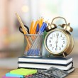 School supplies with clock on wooden table — Foto de Stock