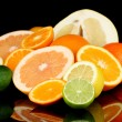 Lots ripe citrus isolated on black - Foto Stock