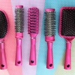 Comb brushes on bright background - Foto Stock