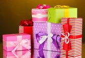 Colorful gifts on orange background — Stock Photo
