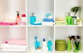Bath accessories on shelfs in bathroom — Stock Photo