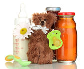 Baby food, bottle of milk and juice with teddy bear isolated on white — Stock Photo