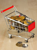 Money in cart on wooden table close-up — Foto de Stock