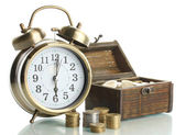Alarm clock with coins in chest isolated on white — Stock Photo