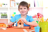 Cute little boy makes birdhouse for birds — Stok fotoğraf