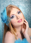 Portrait of beautiful young woman with glamour make up, on blue background — Stock Photo