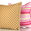 Brown and pink bright pillows isolated on white - Stock Photo