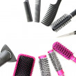 Comb brushes, hairdryer and cutting shears, isolated on white — Stock Photo #19486093