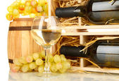 Wooden case with wine bottle, barrel, wineglass and grape isolated on white — Stock Photo