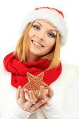 Atrakcyjna młoda kobieta trzyma boże narodzenie gwiazda na białym tle — Zdjęcie stockowe