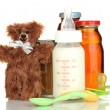 Baby food, bottle of milk and juice with teddy bear isolated on white — Stock Photo #19502913