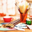 Artistic equipment: paint, brushes and art palette — Stock Photo #19503489