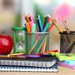 School supplies with apple on wooden table — Stock Photo #19503785