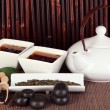 Chinese tea ceremony on bamboo table on bamboo background - Stock Photo