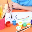 Child painting in his album — Stock Photo #19504097