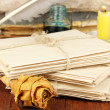 Stacks of old letters on wooden table — Stok fotoğraf