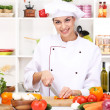 Young woman chef cooking in kitchen — Stock Photo #19507513