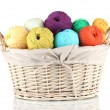 Royalty-Free Stock Photo: Colorful yarn balls in wicker basket isolated on white