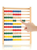 Accountant counting on an abacus, isolated on white — Stock Photo