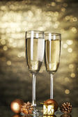 Two glasses of champagne on shine background — Stock Photo