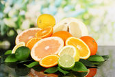 Lots ripe citrus on black table on natural background — Stok fotoğraf