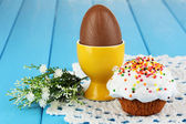 Composition of Easter and chocolate eggs on wooden table close-up — Stock Photo