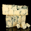 Cheese with mold isolated on black background close-up -  