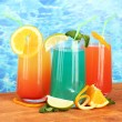 Three coctails on blue background — Stock Photo