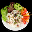 Delicatessen seafood salad with rice isolated on black - Stock Photo