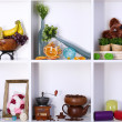 Beautiful white shelves with scattered different home related objects — Stock Photo #19599457
