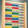 Bright wooden toy abacus, on grey background — Foto Stock