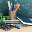School supplies on wooden table — Stock Photo #19599711