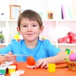 Cute little boy painting easter eggs - Stock Photo