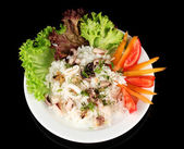Delicatessen seafood salad with rice isolated on black — Zdjęcie stockowe
