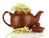 Dried herbs in teapot, isolated on white. Conceptual photo of herbal tea. — Stock Photo