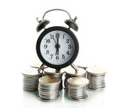 Alarm clock with coins isolated on white — Stock Photo