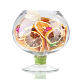 Dried oranges, wicker balls and other home decorations in glass bowl, isolated on white — Stock Photo