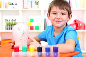 Cute little boy painting clay vase — Stock Photo