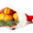 Christmas composition with oranges and fir tree in Santa Claus hat, isolated on white — Stock Photo #19624127
