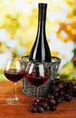 Composition of wine and grapes on bright background — Stock Photo