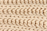 Warm knitted scarf close-up background — Stock Photo