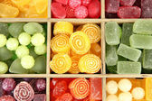 Multicolor candies in wooden box, close up — Stock Photo